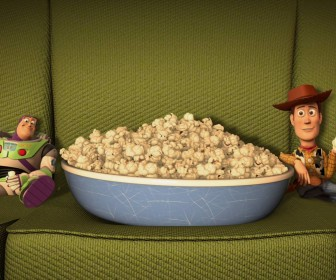 Buzz And Woody Eating Popcorn Wallpaper